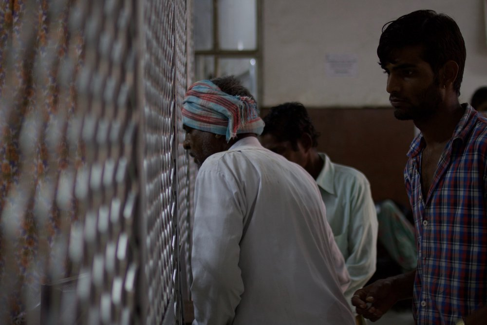 An elderly man approaches the Drug Distribution Counter at the MB Hospital for his monthly medicines.