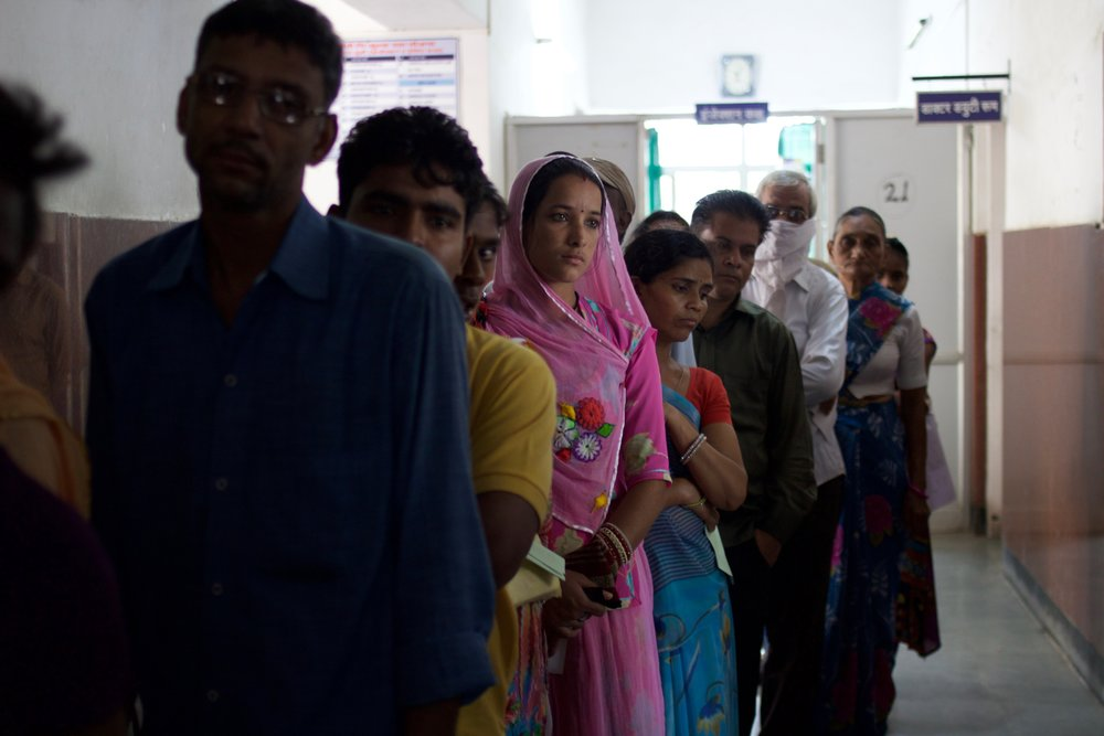 Patients wait in line for their consultation with a general physician at Satellite Hospital Hiran Magri Sector 6.