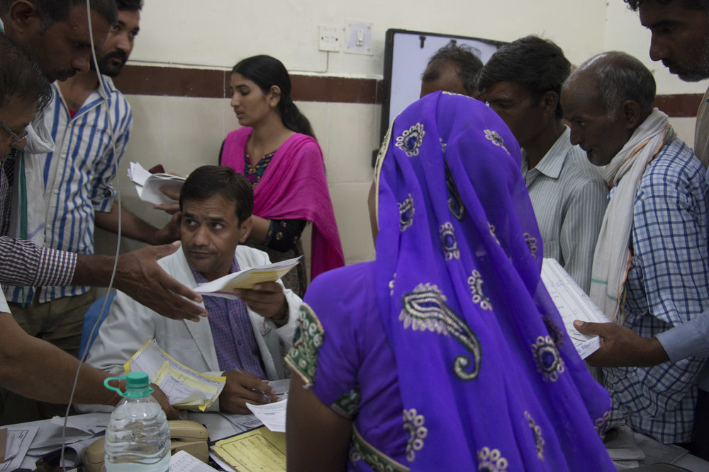 Oncology OPD, Sawai Man Singh Hospital, Jaipur.  The number of patients seeking treatment has increased drastically since the inception of the Scheme. It has put an additional burden on the medical infrastructure. People often wait in queues for hours. Despite the problems, this Scheme has a wide reach and has been able to help the ones in need.