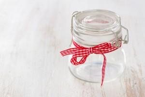 empty glass jar on white wooden background