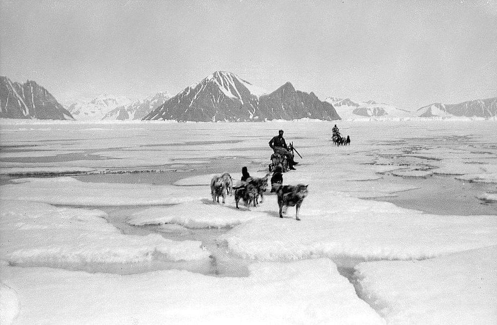 Scott's team on the Tera Nova Expedition crossing ice floes with dogs. Photo Credit: Scott Polar Research Institute.