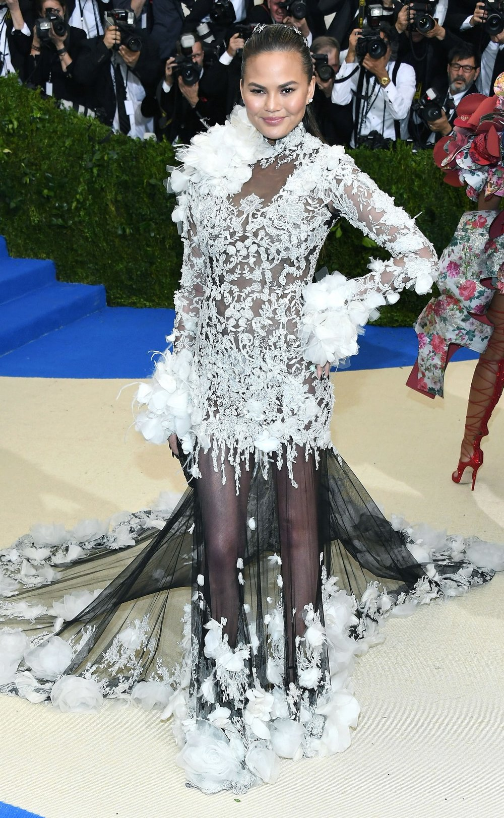 Chrissy Teigen  in Marchesa .  Marchesa is a fashion house that almost never gets it wrong. The sad thing is, they usually only dress one or two major celebrities at events like the Met so they didn't even have a chance to recover from this. This has to be the tackiest gown she's ever worn publicly. I'm getting all the Cruella Deville vibes and not in a good way.