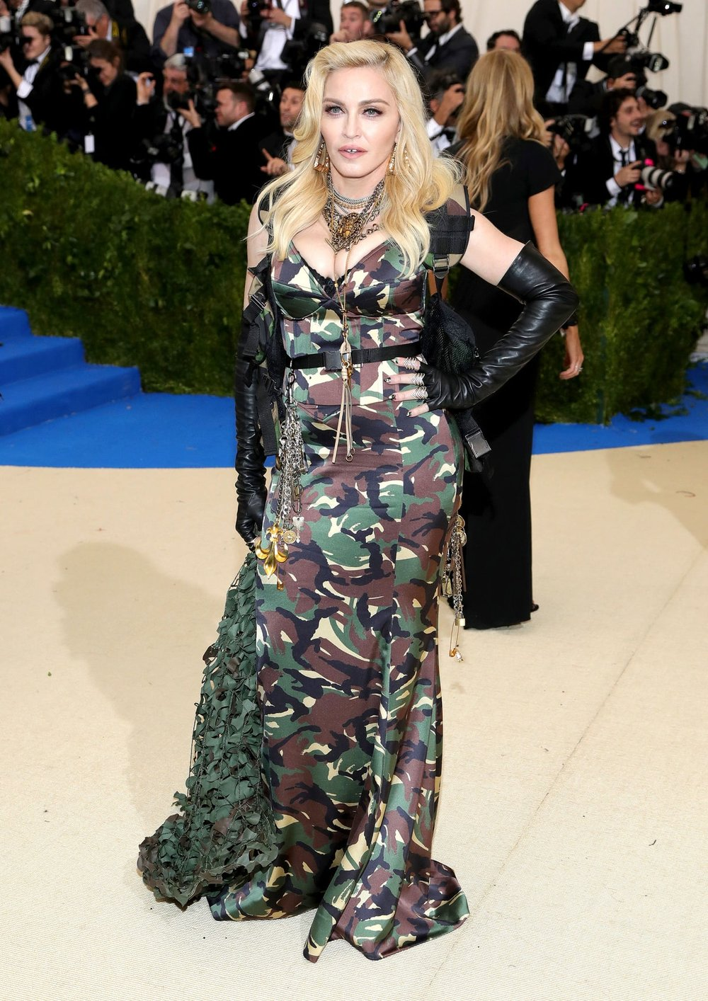 Madonna  in Moschino  . Madonna is the queen of tacky AF. Point proven with this military-inspired, basic training net adored messsssss honey. She could have lived without every single accessory she threw on with this too. At least she left the kitchen sink at home.
