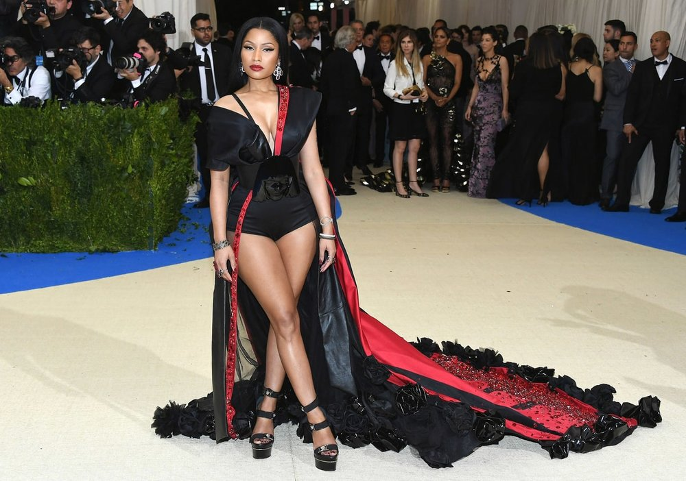 Nicki Minaj   in Custom H&M.  Sit down and be humble Nicki. Trash must be Nicki's new muse because that's exactly where she got this outfit from. Put this back in the bin with your music and her ex's Meek Mill's career.