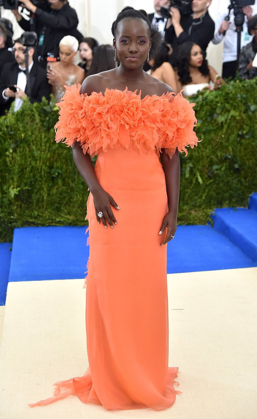 Lupita Nyong'o   in Prada.  The color is amazing. The silhouette is feminine and looks comfortable and soft despite it being a couture gown proving you don't have to be uncomfortable to deliver fashion. I'm not feeling the hair but who cares when everything else is so pretty!
