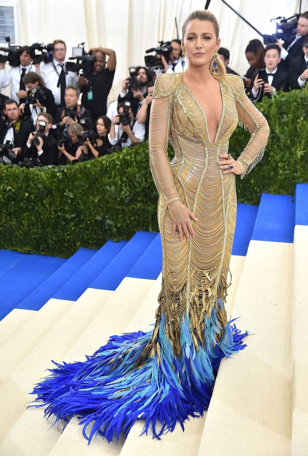 "Blake Lively ""Reynolds""   in Atelier Versace.  She absolutely KILLED IT in this look and solidified her MILF status if we forgot the fact she's a momma of 2. The fact that her feathers match the carpet to a T was definitely planned. She's never used a stylist which makes me love her even more. She always takes fashion risks and like this one, it paid off big time!"