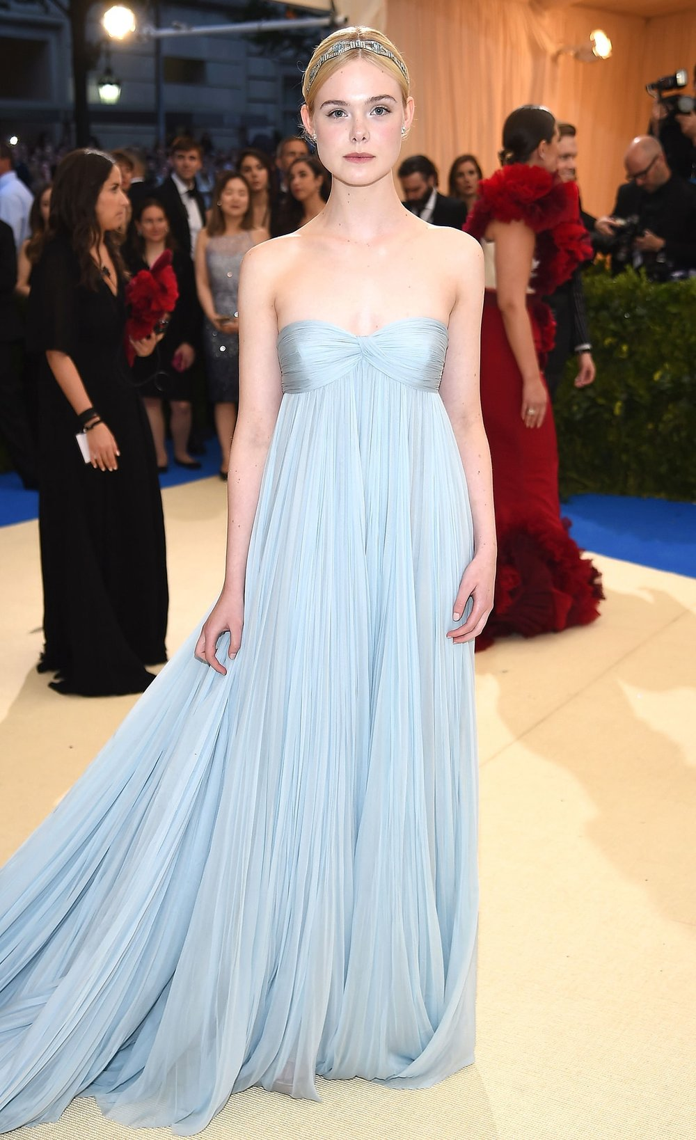 "Elle Fanning   in Miu Miu . Typically the Fanning sisters are sport minimal or ""maximal"" looks. I think she nailed this etherial soft powder blue moment that she had here. She looks youthful and age appropriate for once and elegant without trying too hard."
