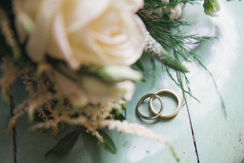 Artistic wedding rings shot. Rustic wedding photography