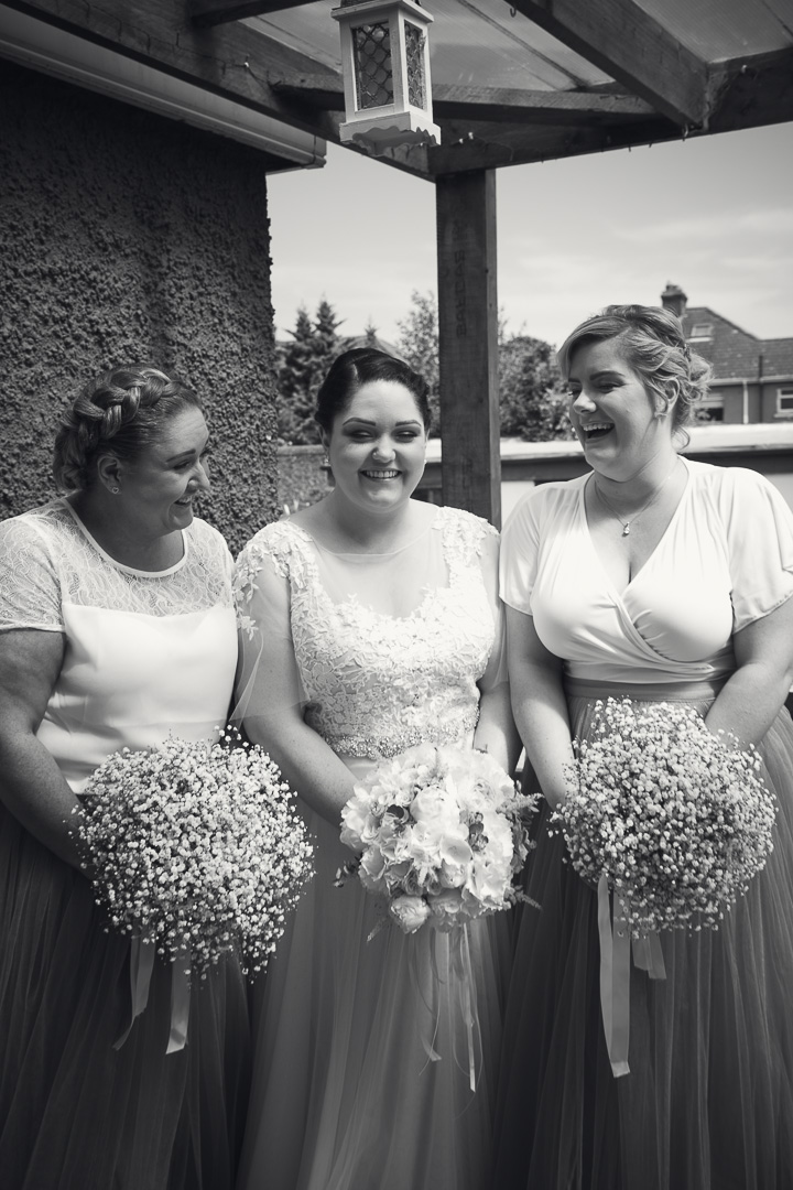 City hall Wedding. Smiling brides maids in black & white