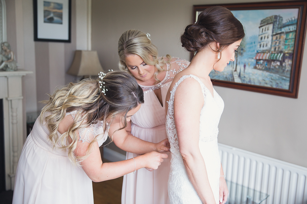 Bride maids helping bride