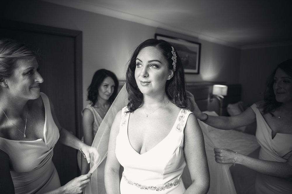 Michelle & David Radisson Blu Hotel & Spa Limerick. Bridesmaids helping the bride