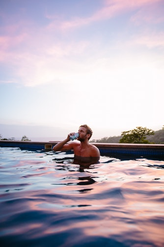 guy drinking in pool.jpg