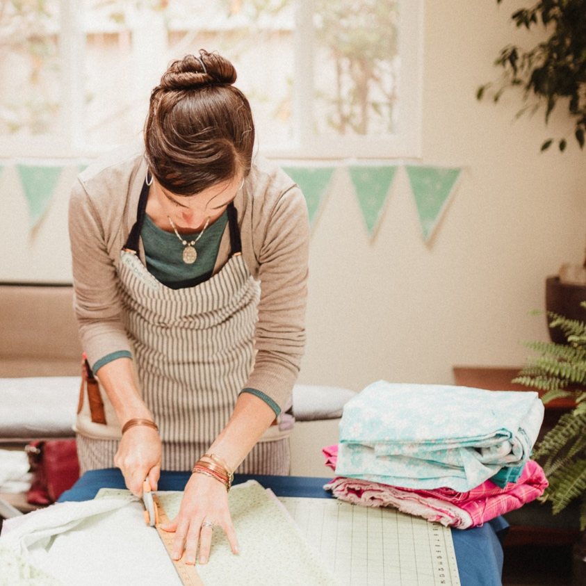 How it all started - Notions sewing studio started as just that… a wild notion. Having spent a good portion of her life sewing Rebecca Hubbard opened Notions Sewing Studio in December 2016. Born out of a love for teaching, a passion for fiber arts, and the challenge of being a small business owner Notions has been a dream come true.From her early childhood Rebecca always saw herself as being an artist. She went to school to study fine art, obtaining her Bachelors of Fine Art from Southern Oregon University. She followed an adventurous life traveling the world creating art, cooking for various crews, living in remote wilderness locations and eventually settling in Eureka, California with her partner. This is where her passion for sewing and teaching met and she began teaching classes in 2012. Through visiting the studio you may notice her passion for art goes beyond the formalities of cloth and paper, ever a gardener and nature-lover, she brings her love for color to the landscape. In her free time she enjoys the company of her husband and their fur and feather family.