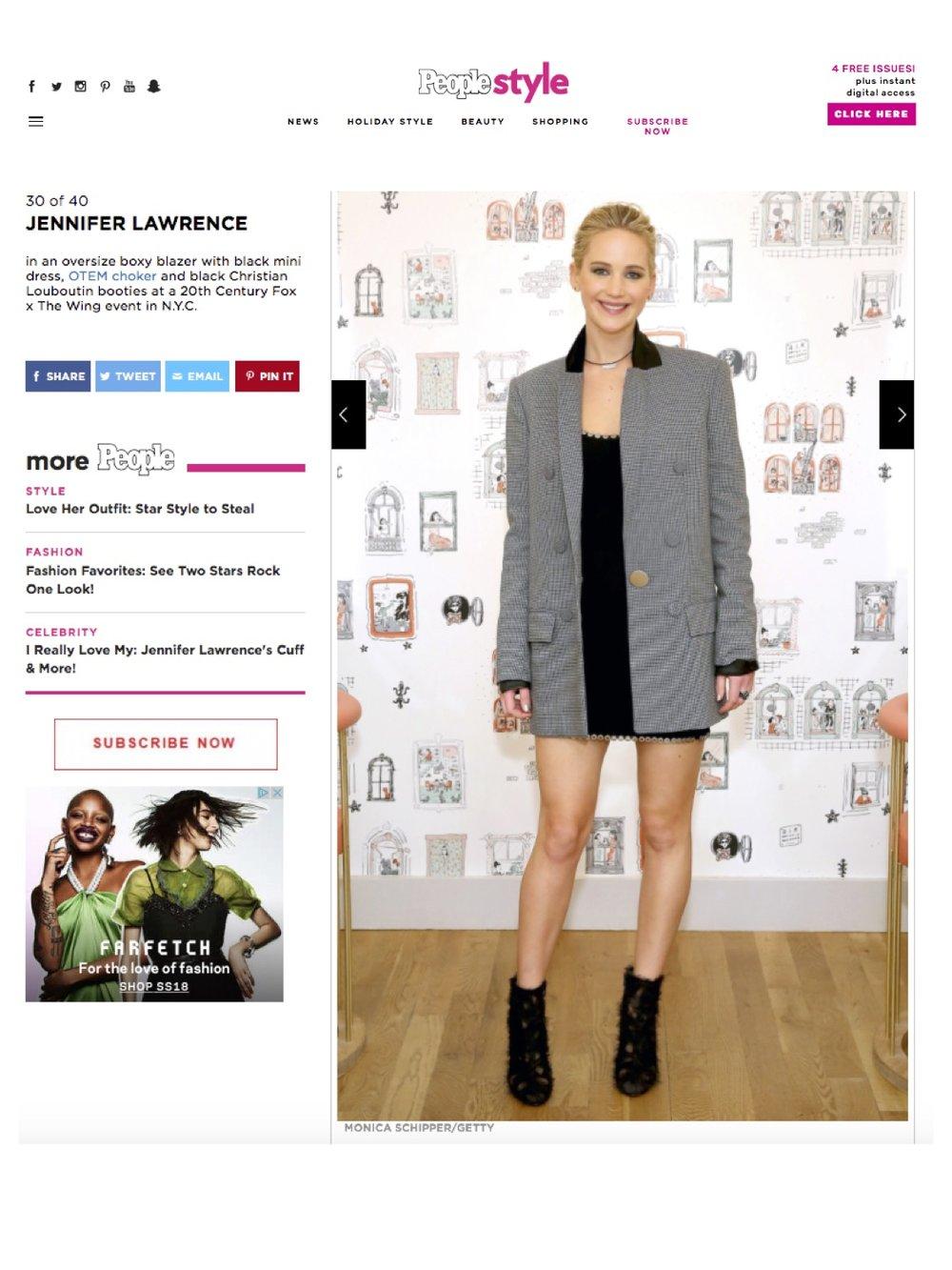 "Jennifer Lawrence debuting her ""PERSIST"" choker.Featured on People magazine."