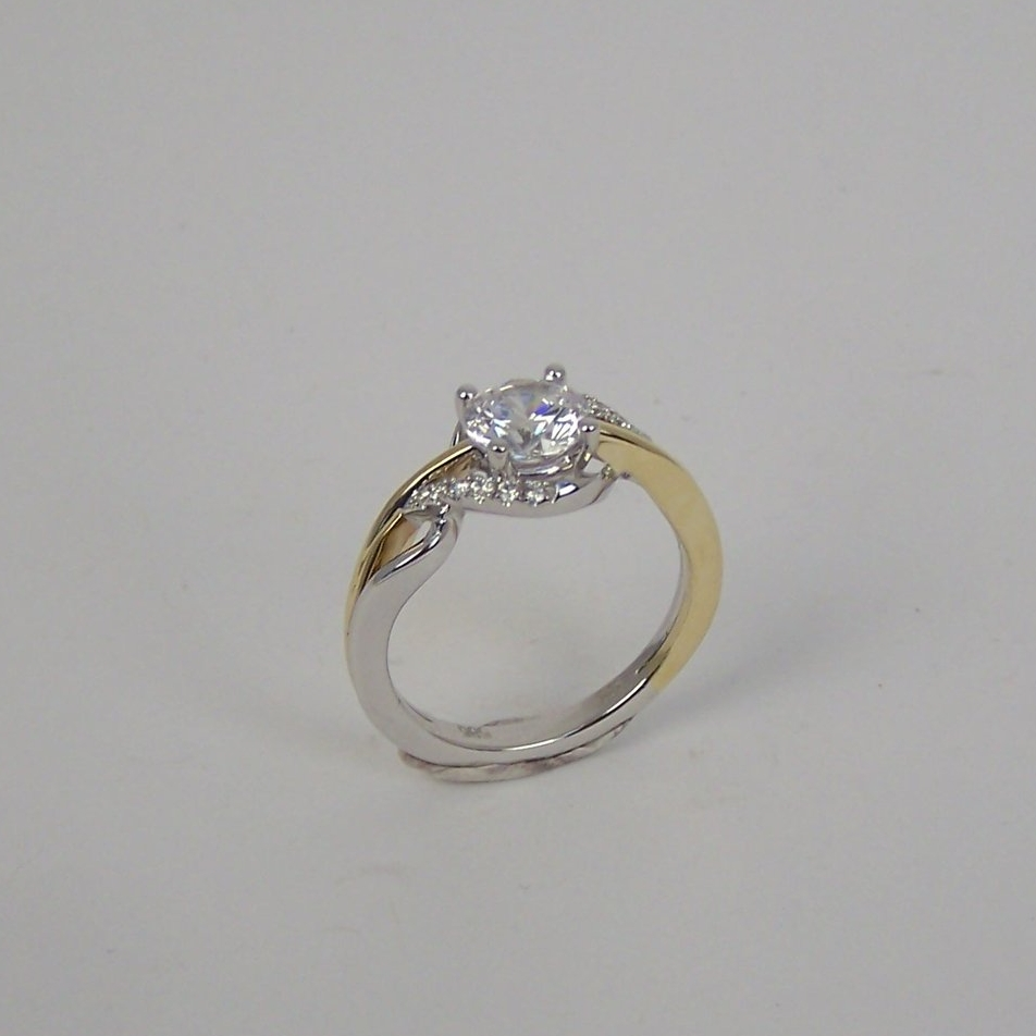 140-387  14 Karat Yellow & White Gold Twist Top Semi Mount Ring with 12=0.10Tw Round Diamonds. Shown with One 1.00Ct Round Cubic Zirconium $2,097.00