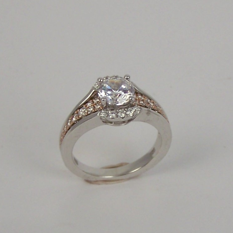 140-412  14 Karat White and Rose' Gold Modified Halo, Split Shank Semi Mount Ring with 34=0.40tw Round Diamonds. Shown with one 1.00 Carat Round Cubic Zirconium. $3,704.00