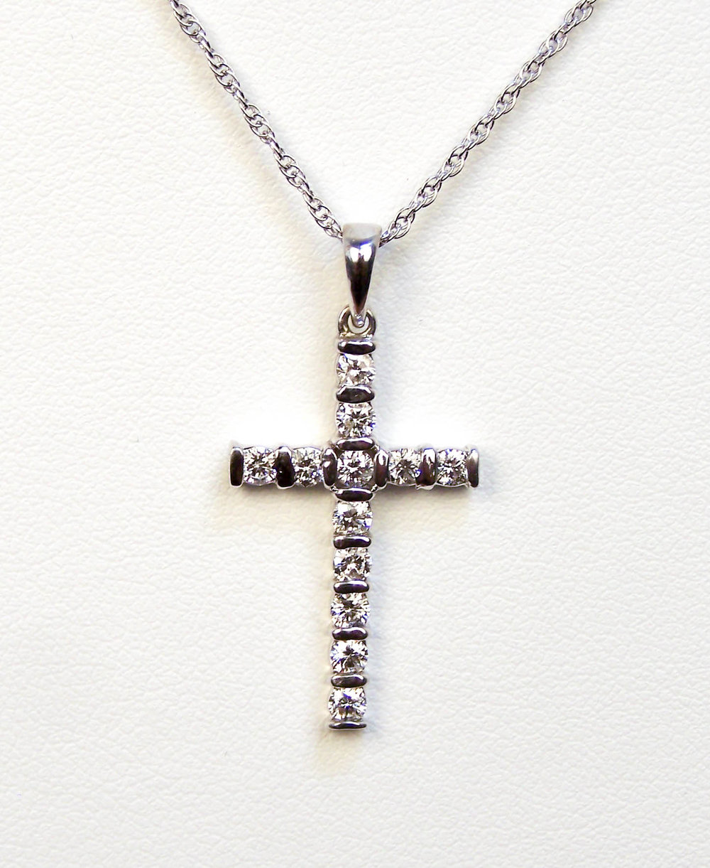 "160-317  14 Karat White Cross Pendant with 12=0.48tw Bar Set Round Diamonds, Color H, Clarity SI2, 18"" Sterling Silver Chain $1,220.00"