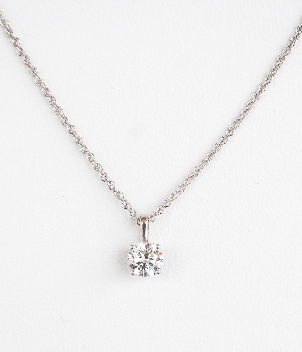 "160-356   Mikesell's 14 Karat White Gold Pendant with One 0.75 Carat Round Diamond, Clarity I3,                                       Color G                                                       18"" Sterling Silver Rope Chain $3,749.00"