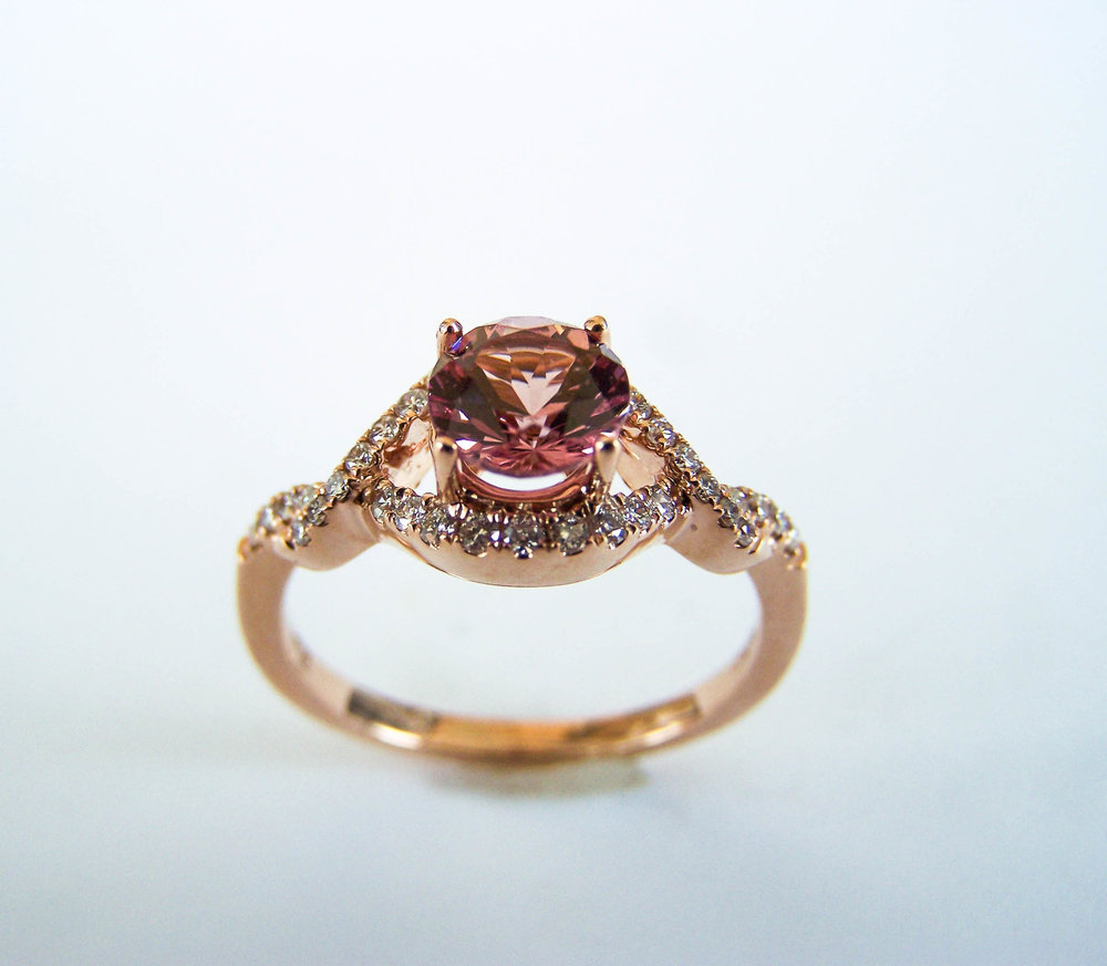 200-711  14 Karat Rosé Gold Fashion Ring with One 0.94 Carat Round Lotus Garnet and 0.21tw Round Diamonds $1,790.00