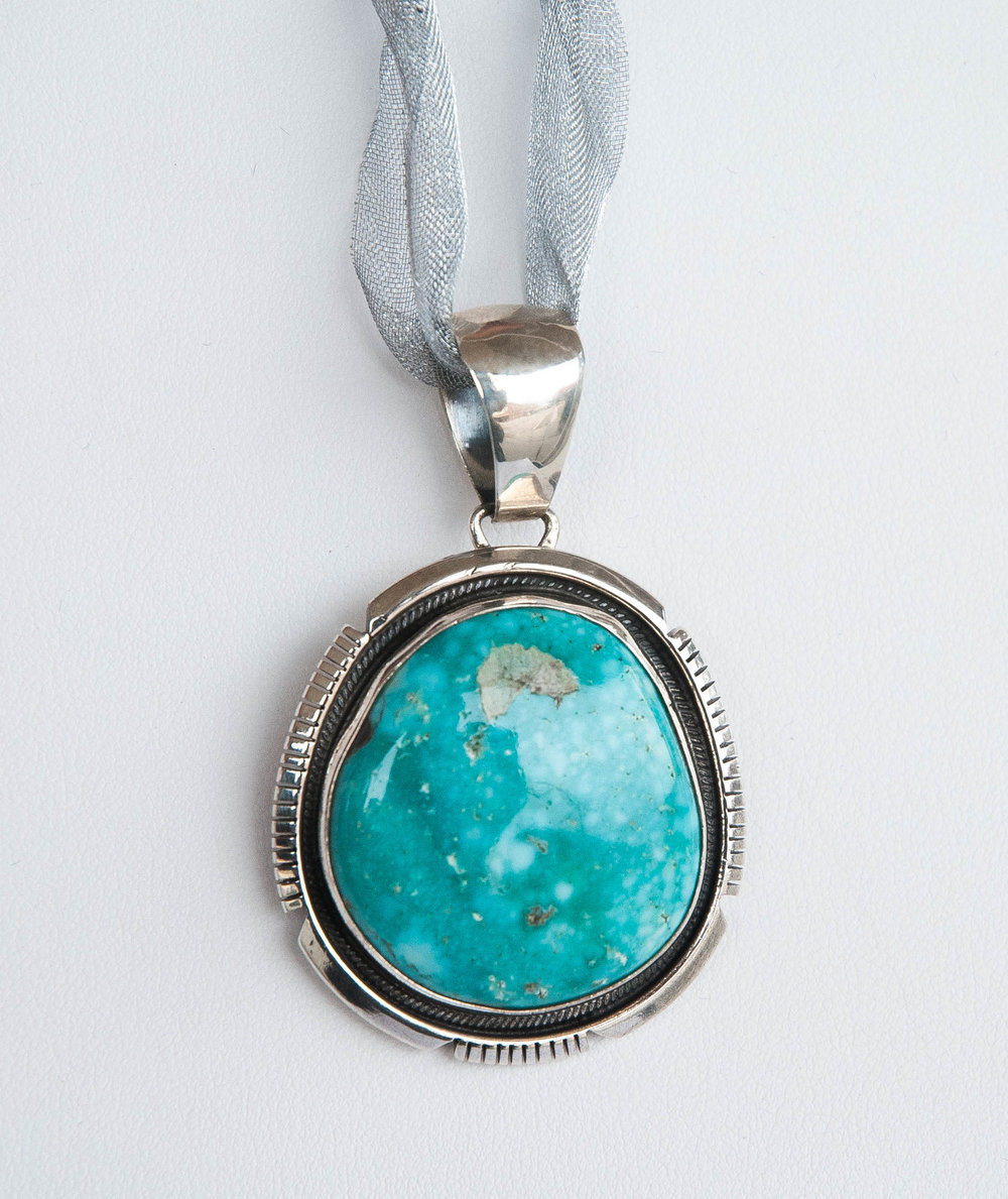 660-903  Sterling Silver Pendant with One Bezel Set South West Turquoise, Hallmarked by the Maker $125.00