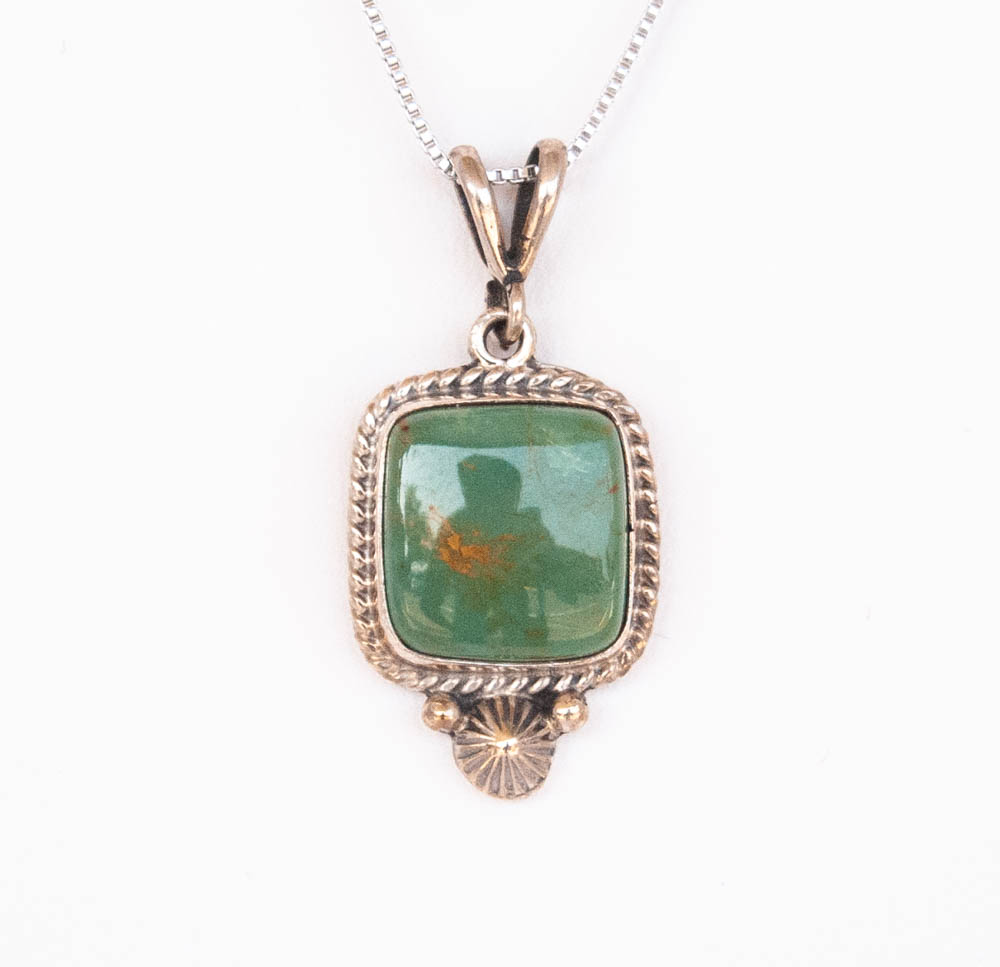 660-850 Sterling Silver Pendant With One Cabochon Turquoise $92.00