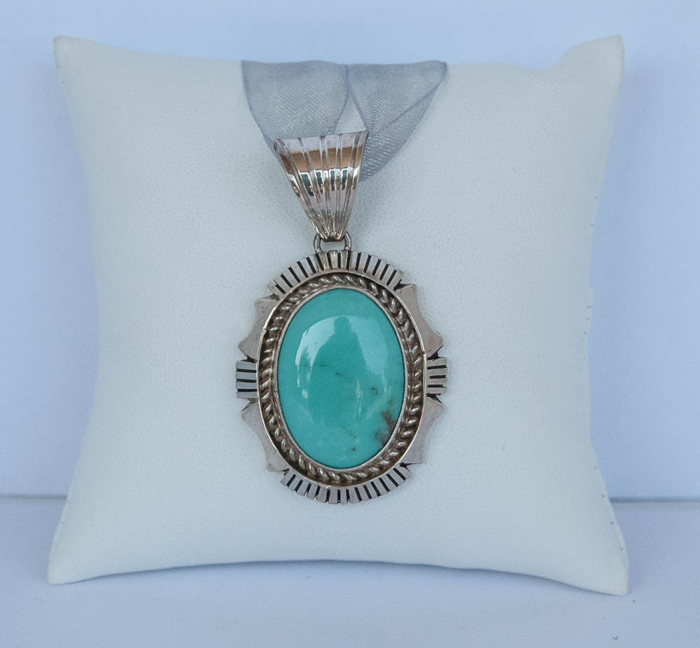 660-847 Sterling Silver Pendant With One Cabochon Turquoise $192.00