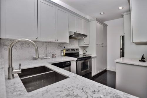 Exclusive Bloor Condo marble kitchen.jpg