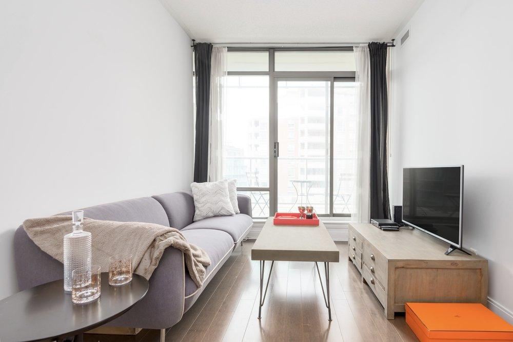 Furnished condo, sofa, table, window
