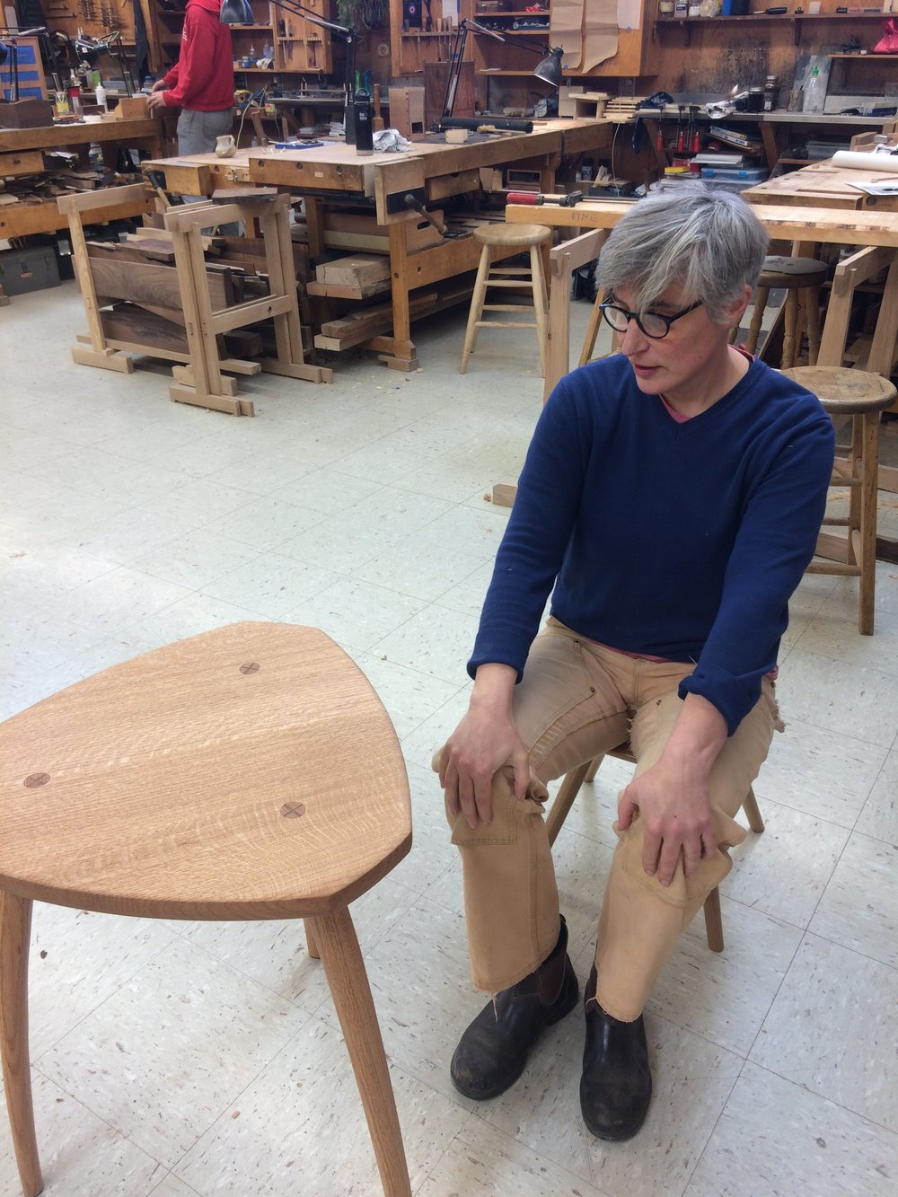 The stools are tested as the class appreciates Noam Wise's black oak cafe table.