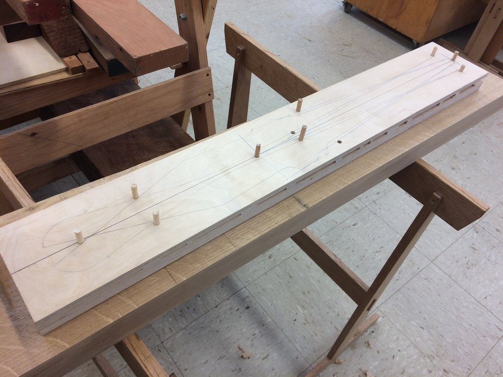 In order to uniformly taper all of the legs, I made this sloped sled to carry the legs through the thickness planer.