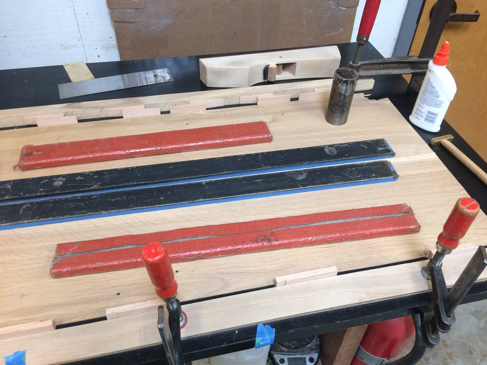 Glue four individual veneers along their edges to create wider sheets that will become one of seven plys per shell piece.