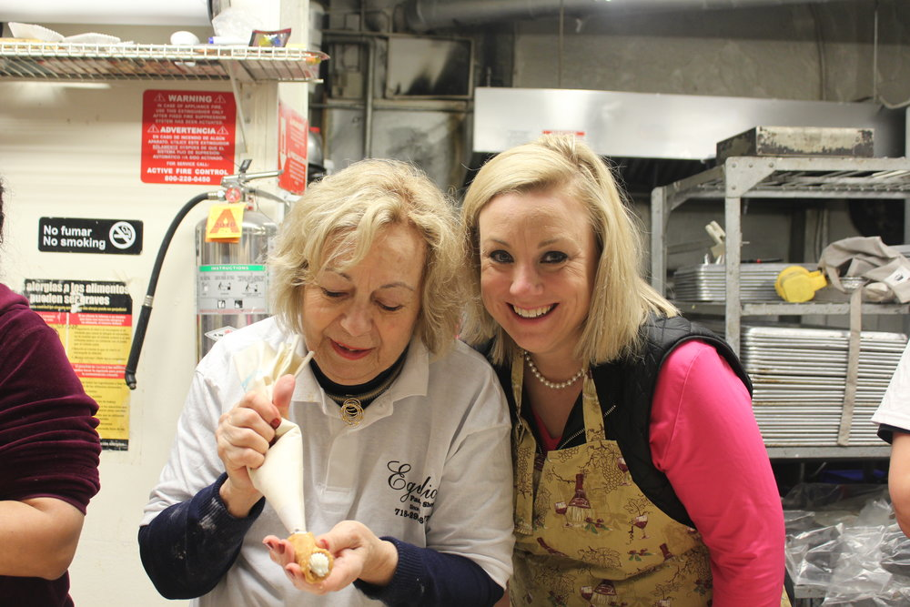 Kathy McCabe from   Dream of Italy Newsletter & TV Show   and her mother Kathy fill cannoli