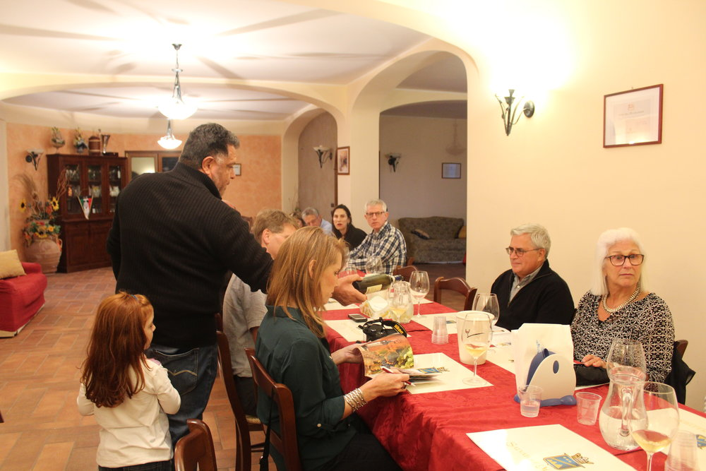 Giovanni Moletierri accompanied by his daughter lead a tasting of their wines in their family home for our 2016 tour guests.