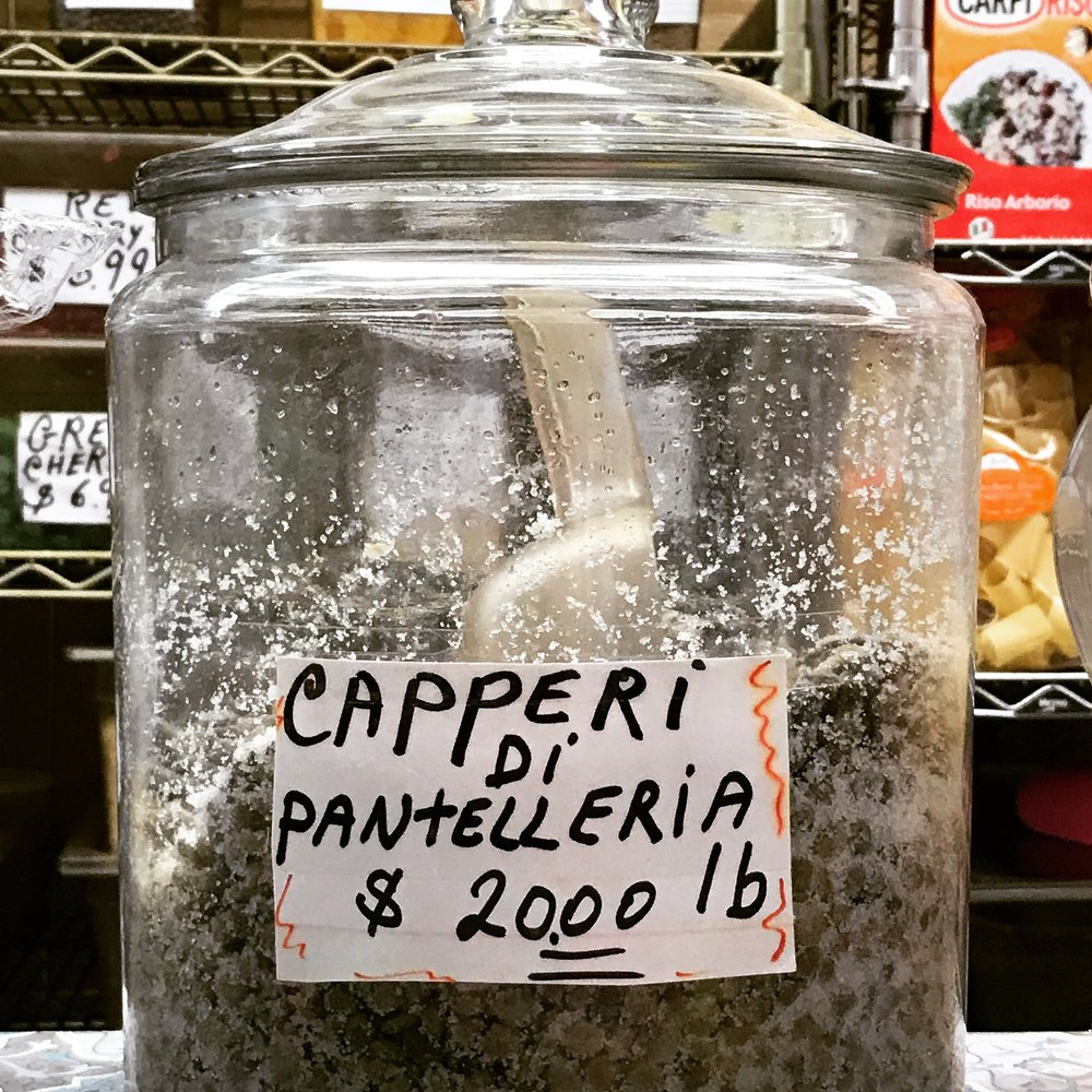 Salted capers from Sicily at Mount Carmel Foods inside the Arthur Avenue Retail Market.