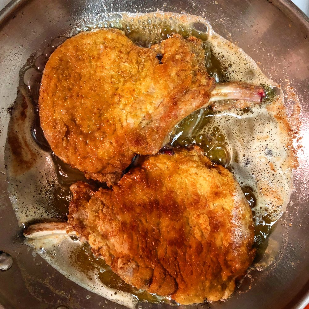 Fry the pork chops until golden brown on both sides, then pour plain white vinegar over them.