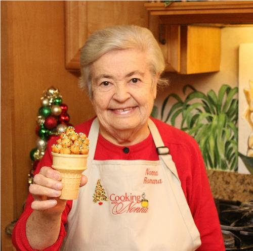 Nonna Romana holding a struffoli cone