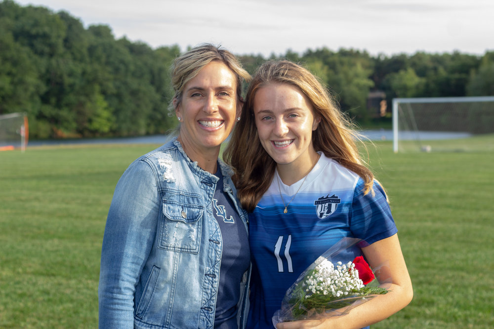 Haley and her mom, Amie Harkness (left), at the 2018 girls' soccer senior night.