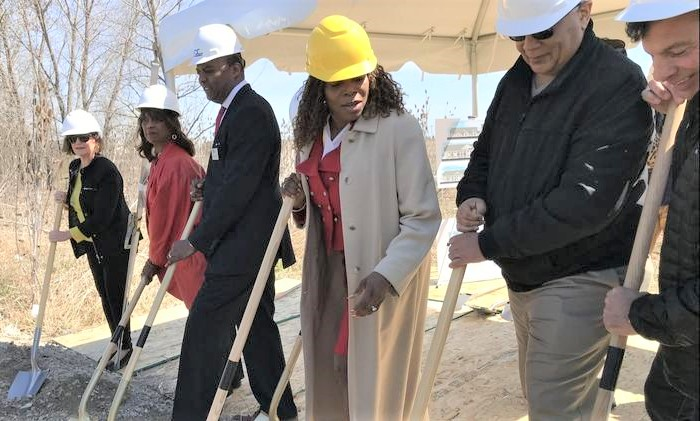 Matteson Mayor Sheila Chalmers-Currin (yellow hard hat) participates in ceremonial groundbreaking for Alexi Senior Living