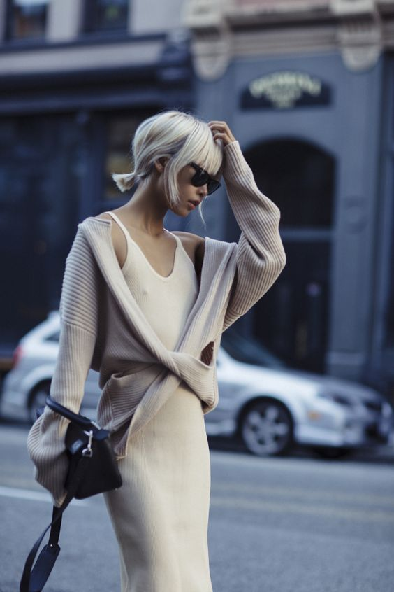 Vanessa Hong    layers her slip dress with a wrap sweater and looks effortlessly chic.