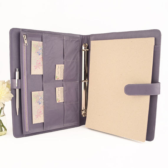 Lavender Leather. - This was one of the first things I purchased as a gift to myself when I started my business. My lavender leather binder is so cute! It's personalized with