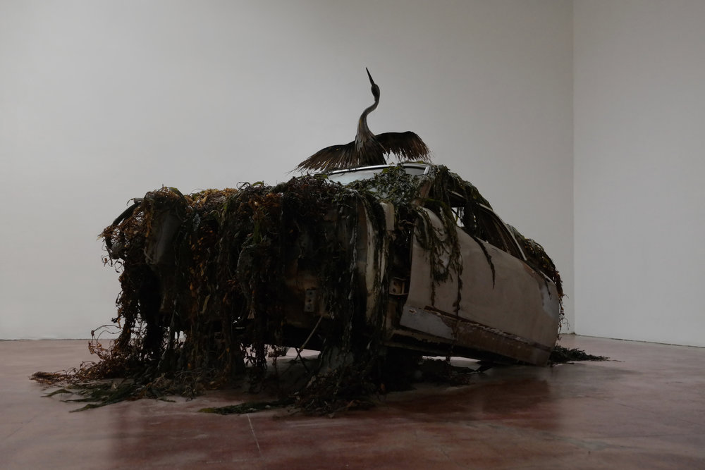 Hydrogenesis 1970 El Camino, sand, bronze heron, palm leaf, seaweed, cement, wood, candle, sea urgent, salt 2017