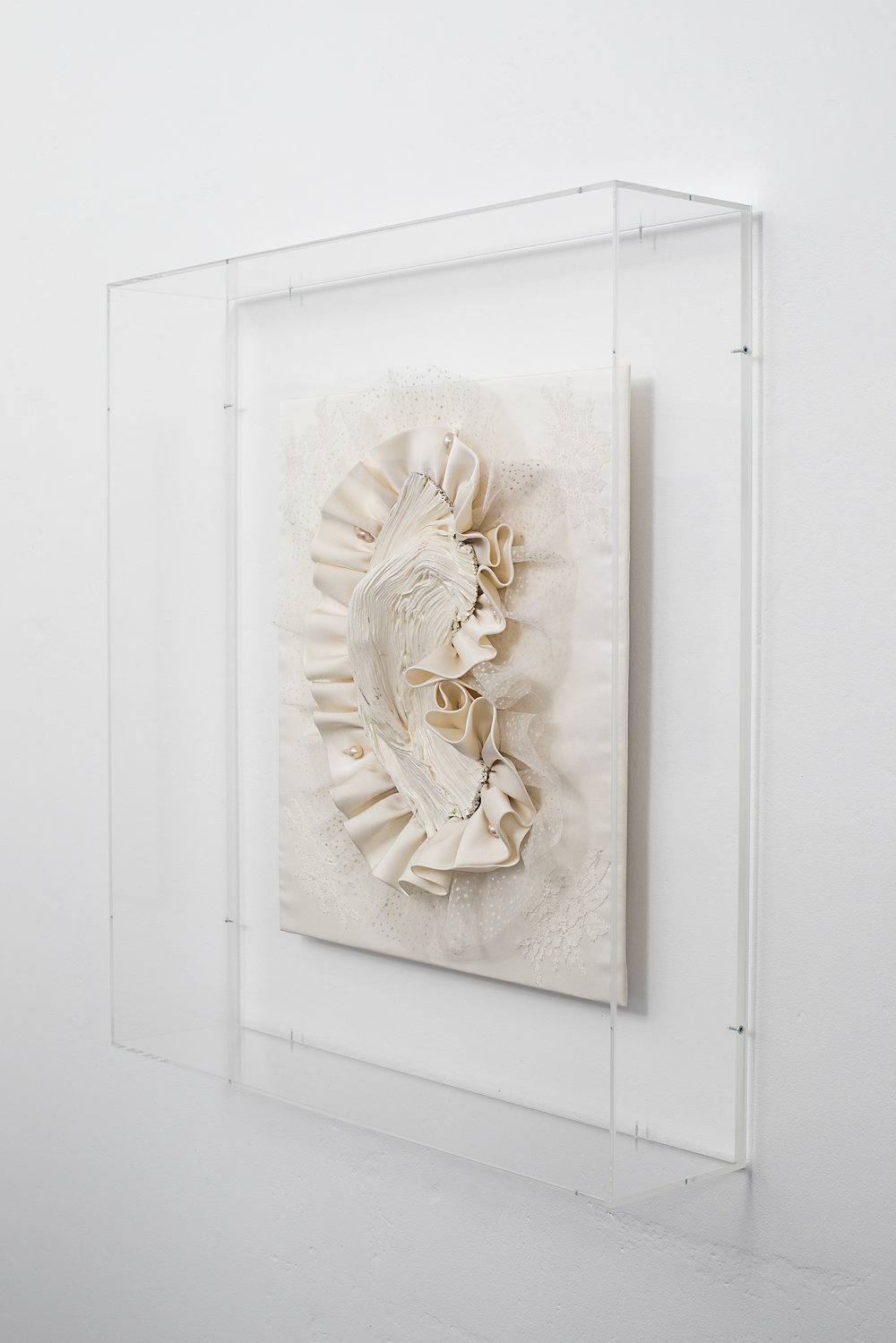 Side detail of Gabriella Loeb,  relic,  silk satin, lace, baroque pearls, plexiglass 61 x 66 x 14 cm