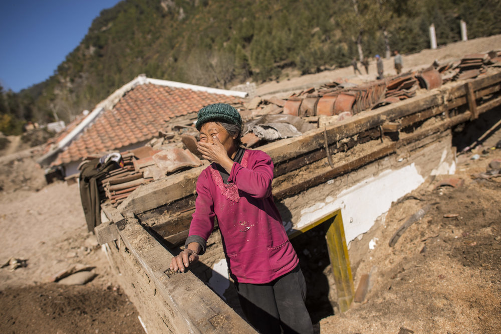 """""""Everything turned into a sea for three days."""" Shin Bong-Suk(65) stands in the ruins of the home where she and her family lost all their personal belongings and household assets."""