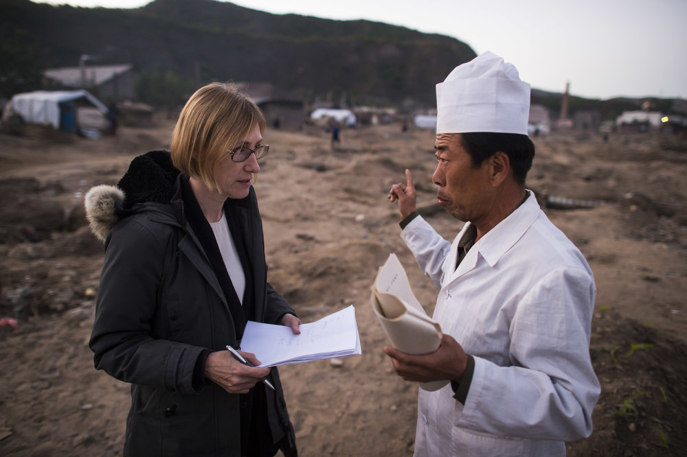 Dr. Lim Kyong-Hwa is treating patients in a tent just a few metres from where his clinic stood before it was completely washed away in the flood.