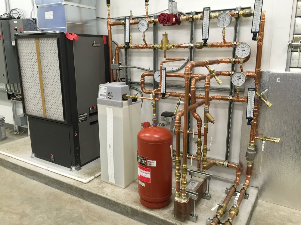 High efficiency HVAC heat pump system in the Summit pump station, which uses the water in the pipelines for a heating and cooling transfer medium.