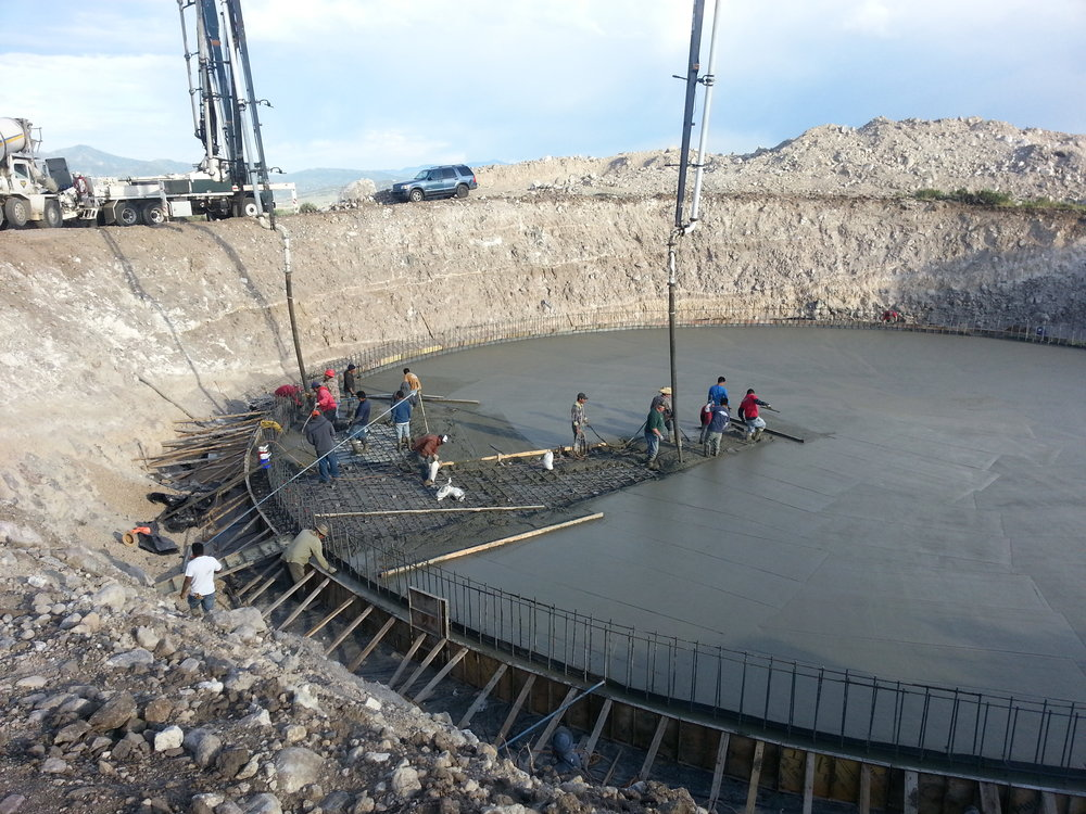 Pouring the floor and footing of the new water tank.