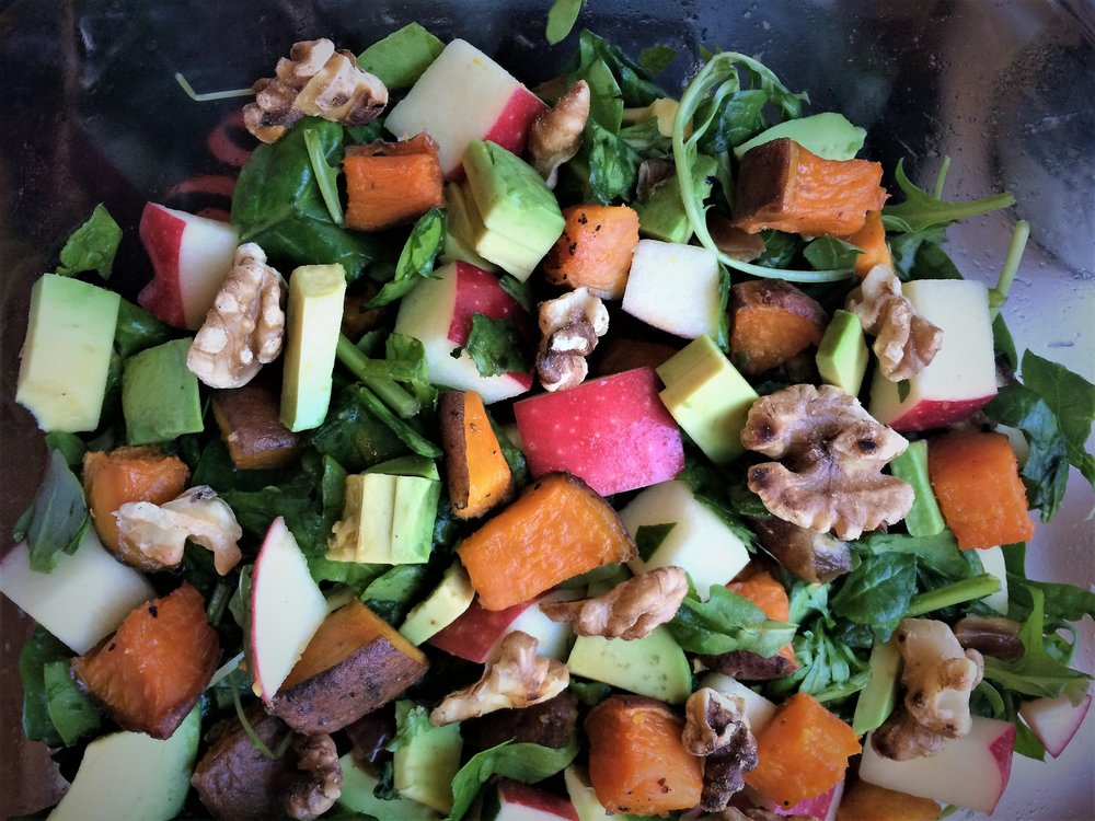 leafy greens salad with apples, roasted sweet potatoes, dates, toasted walnuts and maple balsamic dressing || planting my roots