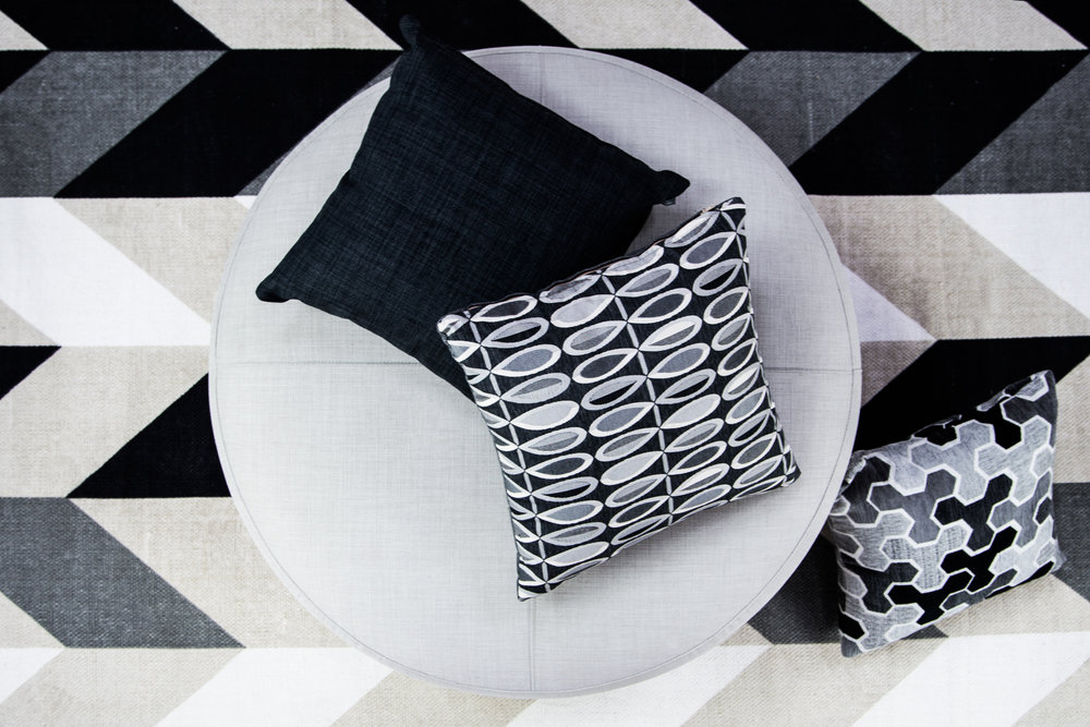 Polly Ash with Lunar Graphite and Carlisia Black Scatters with Lunar Soft Grey on ottoman