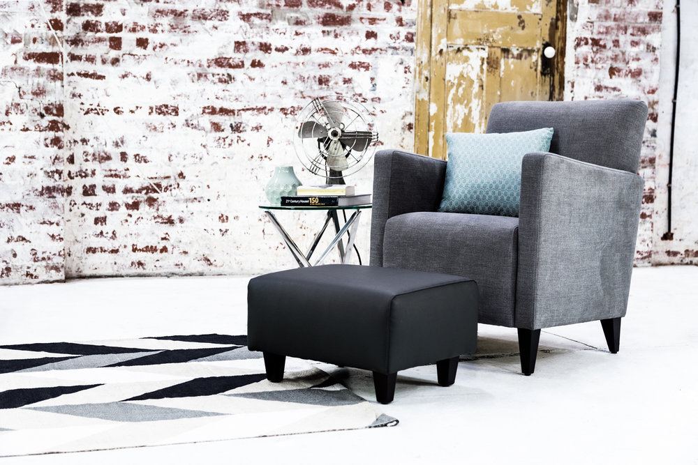 Ottoman: Safari Volcanic Rock. Chair: Obsession Ashwood. Scatter: Tribeca Teal.