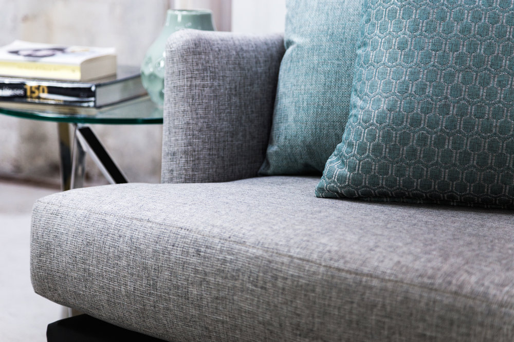 Scatters (from left to right): Echo Teal, Tribeca Teal. Sofa: Stamford White Ash.